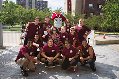 Photo of Sam the Minuteman and students for campus movein