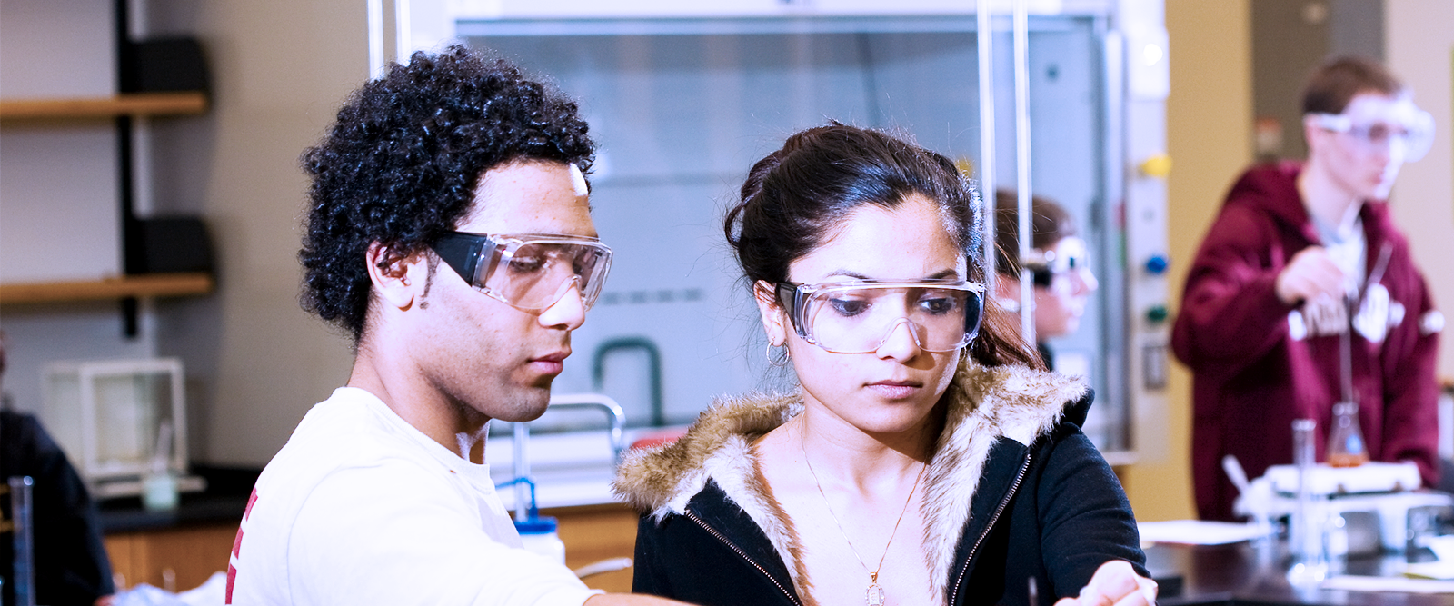 Two undergraduate students work together in an Integrated Sciences Building lab
