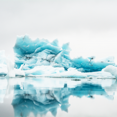 Icebergs floating in arctic setting