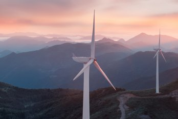 Wind turbines in front of a sunset