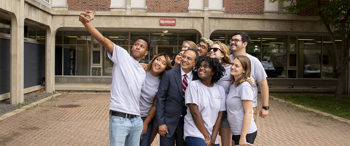 Chancellor in a group selfie with students at move-in day for first-years, September 2018
