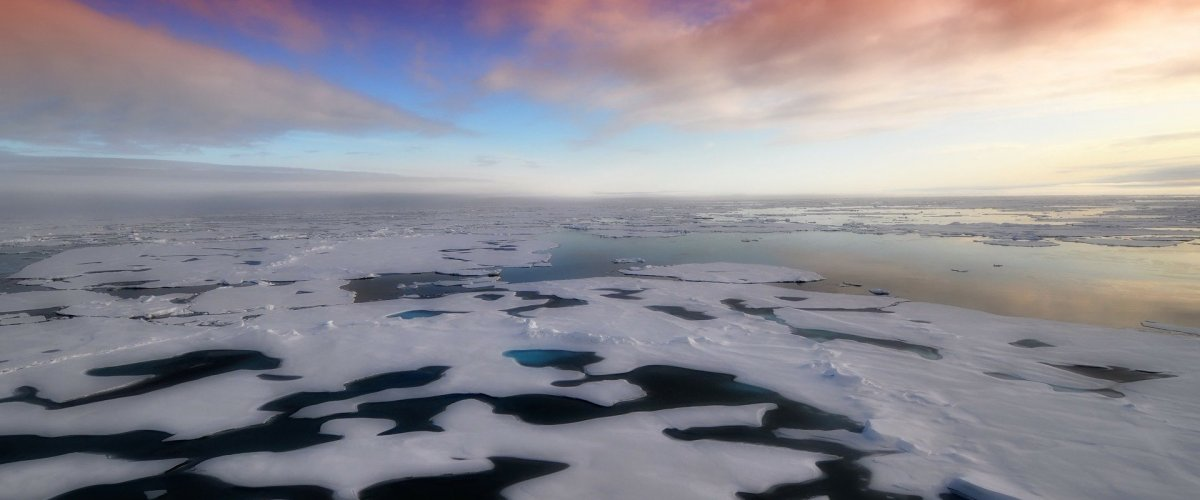 Ice over the ocean at sunset