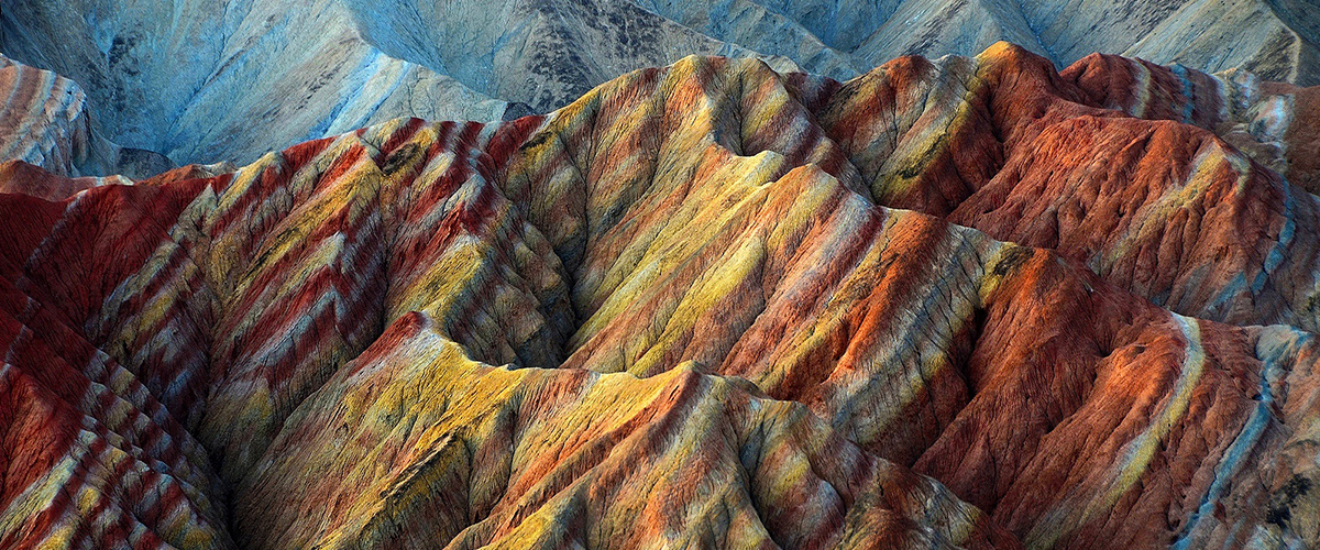 Mountains with stripes of different colored rock