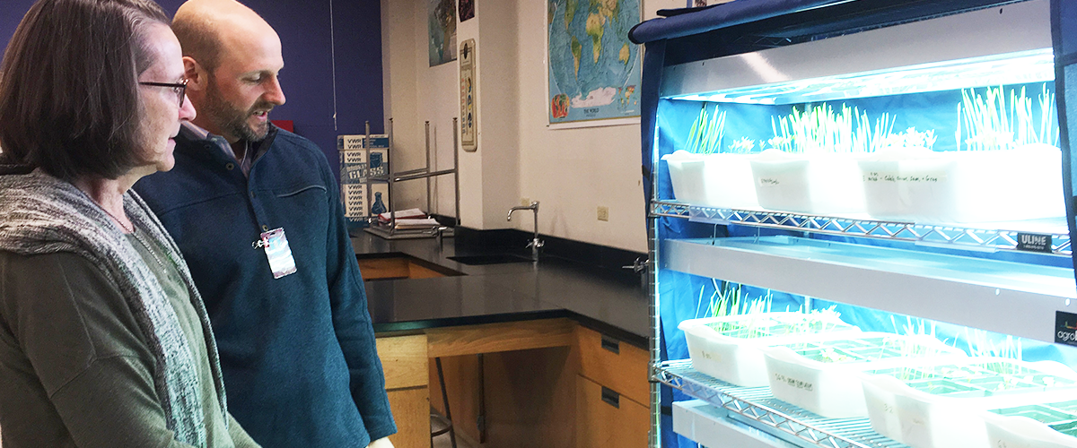 Researchers view plants on newly installed racks in science classroom