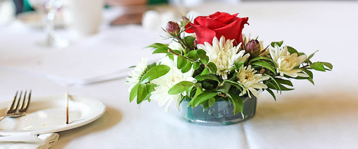 Floral centerpiece on table at celebration