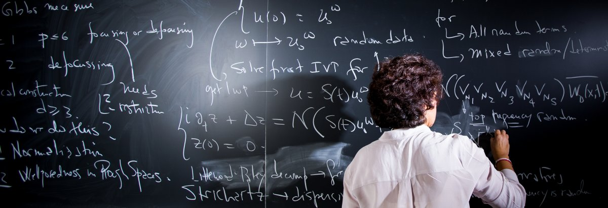 Researcher at chalkboard