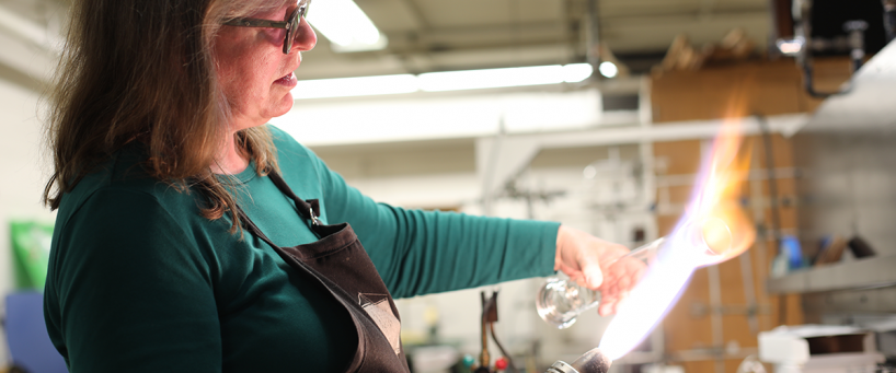 Sally Prasch working with glass in flame
