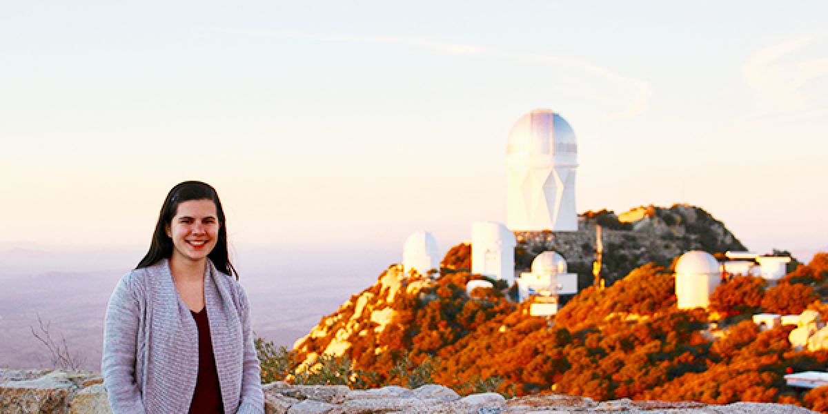Sarah Betti at Kitt Peak Observatory in Arizona. Photo by Dr. Kimberly Ward-Duong